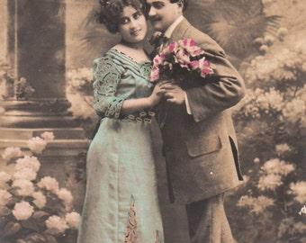 Romantic vintage french lovers postcard . Romantic couple love postcard.