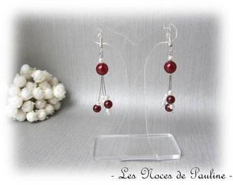 Has Burgundy and ivory three asymmetrical dangle earrings