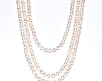 Extra Long Layered Knotted Pearl Necklace.