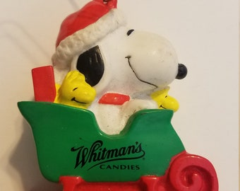 1996 Peanuts Snoopy Christmas Ornament PVC Whitman's Candies, Woodstock sleigh