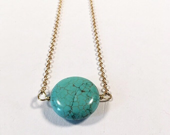 Turquoise magnesite on gold.