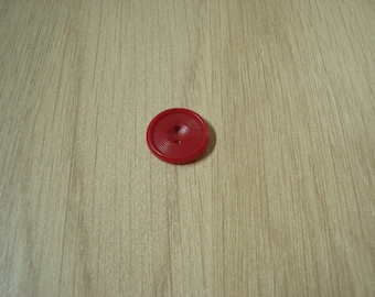 vintage button with red disk