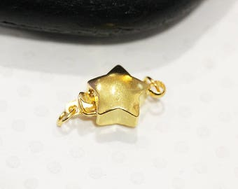 Star toggle with gold rings