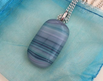 Beautiful stripy fused art glass necklace in turquoise tones.