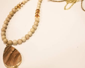 Cream/tan beaded long statement necklace with tassel