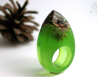 Pine cone – an unique ring with a real brown pine cone in a ring made of green opaque and green transparent resin