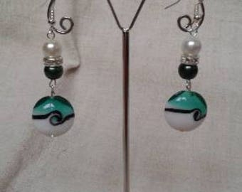 Green and white spiral earrings