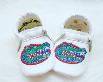 Gators Moccs, baby Moccs, baby moccasins, baby shoes, whitemoccs, leather Moccs, Gators.