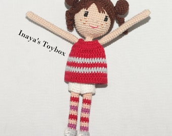 Art doll with red top and shorts