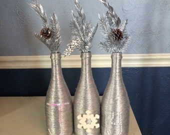 Metallic Silver Christmas Wine Bottle Centerpiece that spells Joy