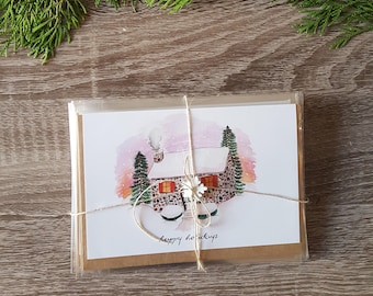 Pack of 10: Cozy Home in the Snow wishing Happy Holidays Illustrated Card