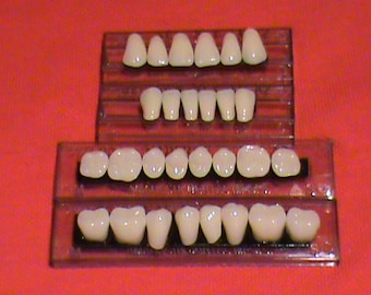 One complete set of acrylic resin denture/false teeth. Available in shade A2 size 22