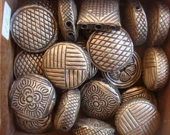 Beads and buttons made from sterling imported from Thailand, Nepal and India