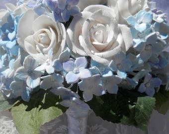 Something blue. Roses white and hydrangeas