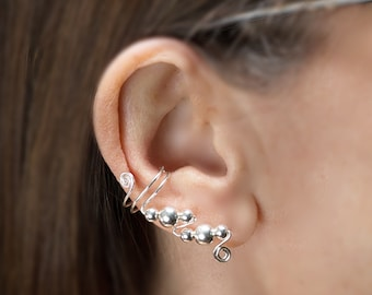 Ear Cuffs from Sterling Silver Wire and Beads, simple elegance and oh so comfortable. Timeless elegance for young ladies of all ages.