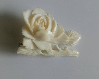 Vintage carved celluloid rose brooch