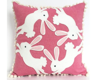 Bunny Ears Pillow in Pink and White Trimmed in Creamy White Pom Poms