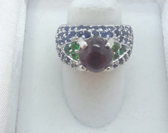 14 Karat White Gold ring with different gems