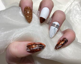 Copper and Marble Stiletto false press on nails.