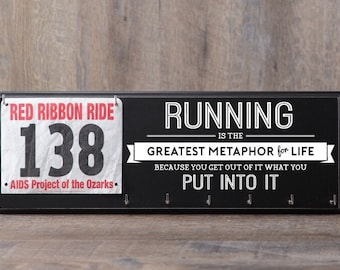 Running bib and medal display with inspirational running quote.