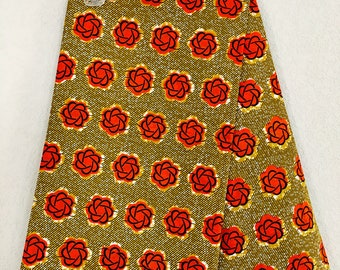African Fabric - by the yard - Wax/Dutch - Tan, orange, black, white - floral crest pattern