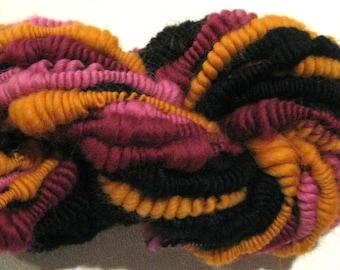 Handspun yarn Bonita supercoil  bulky art yarn 24 yards black pink orange maroon merino knitting supplies crochet supplies Waldorf doll hair