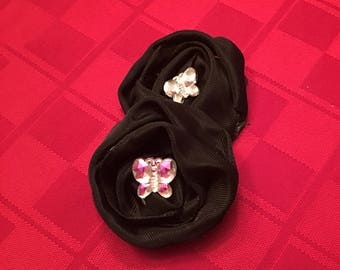Black satin rosettes with rhinestone butterfly center
