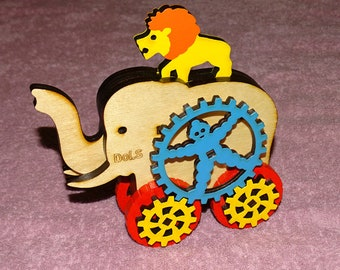 Elephant. A lion. Circus. Wooden elephant. The elephant on wheels. A wooden toy.