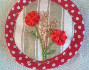 embroidered brooch