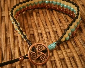 0093-Copper, turquoise, and gold ladder bracelet