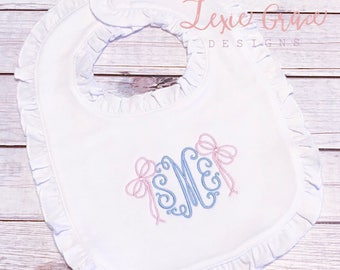 White Ruffled Bib with monogram and bows, embroidered, baby girl