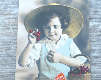 Vintage 1900s recolored French postcard  boy  with cherries