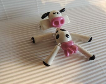 Small articulated cow brooch