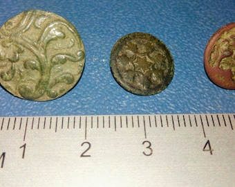 Three antique brass buttons of the 19th century