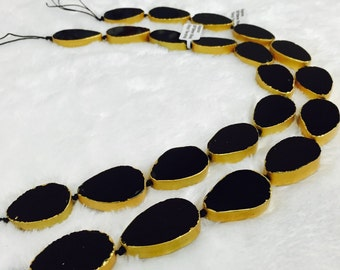 "Genuine Black Onyx Teardrop Golden Bezel Bead. Size approximately 20x30mm per piece, Length 16"" per strand  I-ONY-0315"