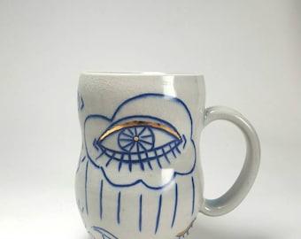 Evil eye in the sky mug