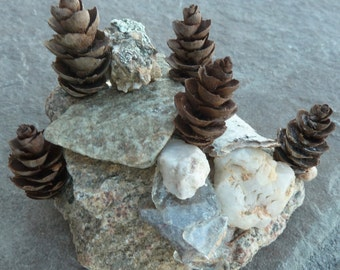 Zen rock garden sculptured from Colorado rocks, mountain glass and tiny pinecones, miniature sculpture from Colorado, original rock art
