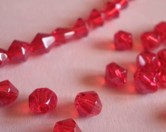 50 4 mm red glass bicones
