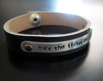 buy the ticket take the ride... leather and metal handstamped cuff bracelet
