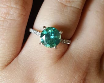 Green moissanite silver ring with accent