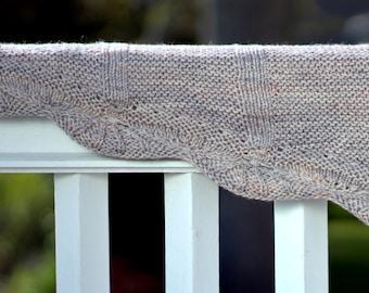 Sunburst, a crescent shaped shawl with a sunburst motif edging, PDF pattern