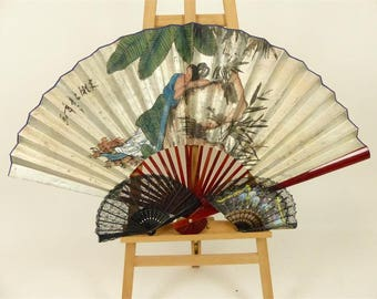 Three fans, including a large Chinese fan depicting a sleeping lady