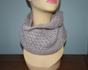 Textured infinity scarf in oatmeal.