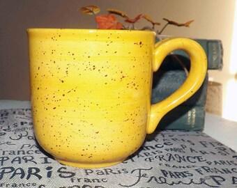 Vintage (1980s) Pfaltzgraff Nuance of Gold stoneware large coffee | tea mug.  Sunny yellow, black flecks. 20-ounce capacity.