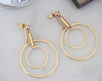 Gold-tone orbit earrings