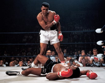 Muhammad Ali Stands Over Sonny Liston in Lewiston Maine 1965 - 8X10 or 11X14 Photo (ZY-551)