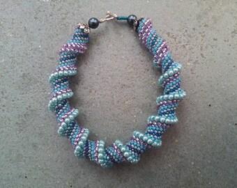 Cellini Spiral Bracelet, beadwork, peyote stitch in blues and purples