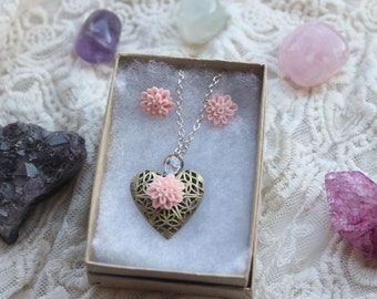 Beautiful filigree heart locket and pink flowers necklace and stud earring set. Silver plated Dahlia flower set in dusky pink.