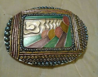 West Germany resin scarf clip.  Art deco pattern.