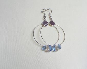 Silver earrings with blue and transparent pearls